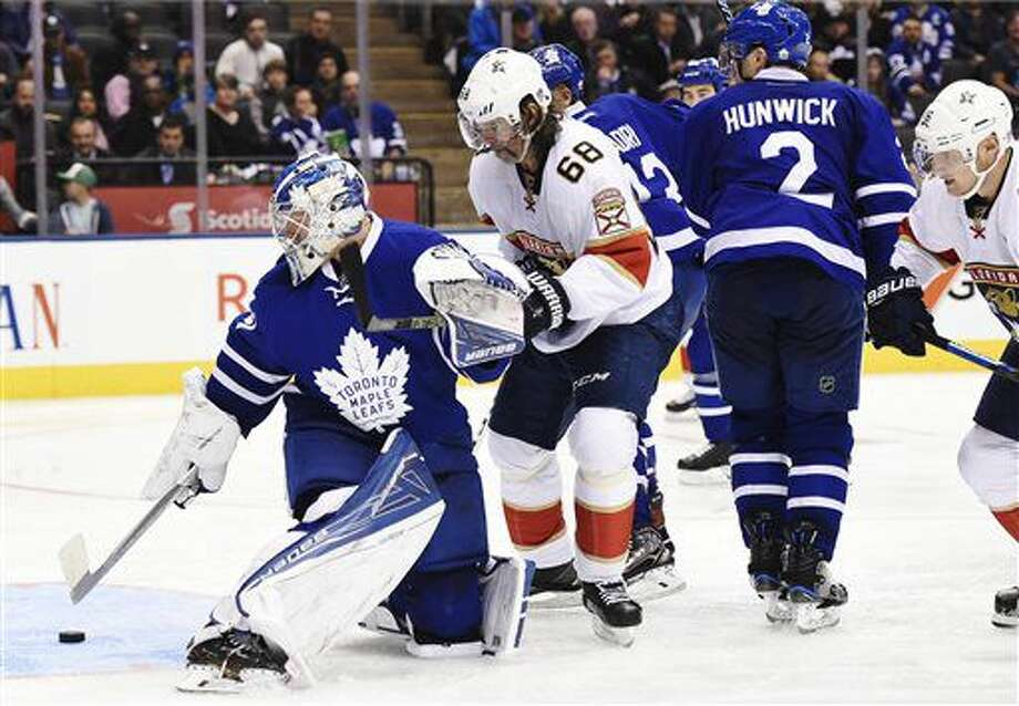 Toronto Maple Leafs goalie Frederik Andersen (31) looks for the puck with Florida Panthers right wing Jaromir Jagr (68) during third-period NHL hockey game action in Toronto, Thursday, Nov. 17, 2016. (Nathan Denette/The Canadian Press via AP)