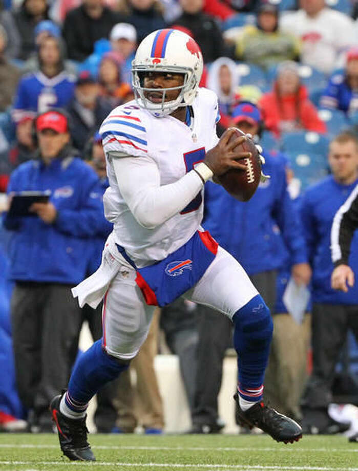 FILE - In this Oct. 30, 2016, file photo, Buffalo Bills quarterback Tyrod Taylor (5) runs with the ball during the second half of an NFL football game against the New England Patriots, in Orchard Park, N.Y. The Buffalo Bills host the Bengals on Sunday. (AP Photo/Bill Wippert, File)