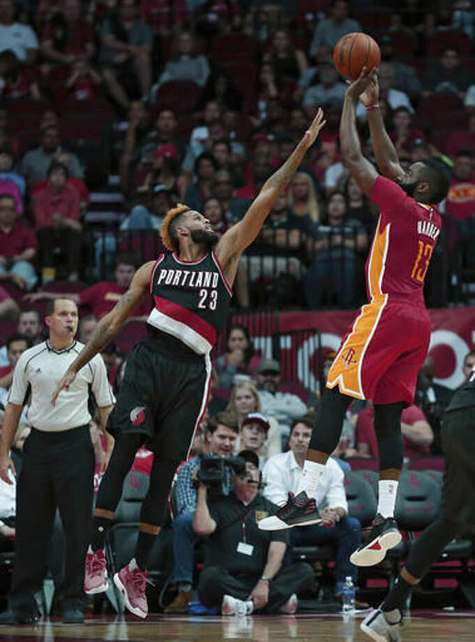 Houston Rockets guard James Harden (13) shoots over Portland Trail Blazers guard Allen Crabbe (23) in the first half of an NBA basketball game on Thursday, Nov. 17, 2016, in Houston. (AP Photo/Bob Levey)