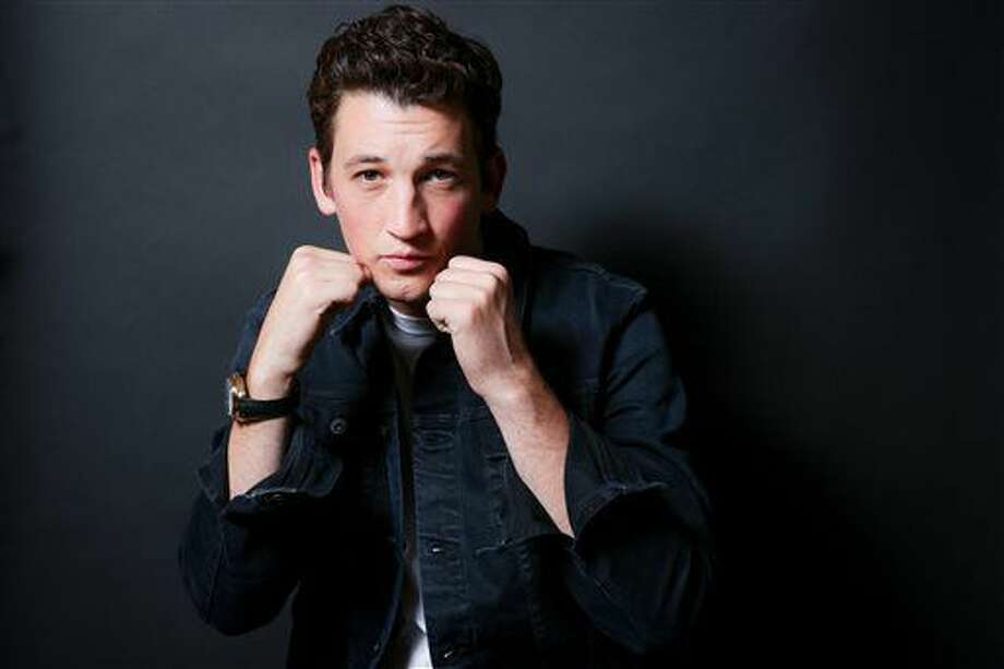 "In this Oct. 29, 2016 file photo, Miles Teller poses for a portrait in Los Angeles to promote his film, ""Bleed For This."" Teller portrays boxer Vinny ""Paz"" Pazienza in the film opening Friday, Nov. 18. (Photo by Rich Fury/Invision/AP)"