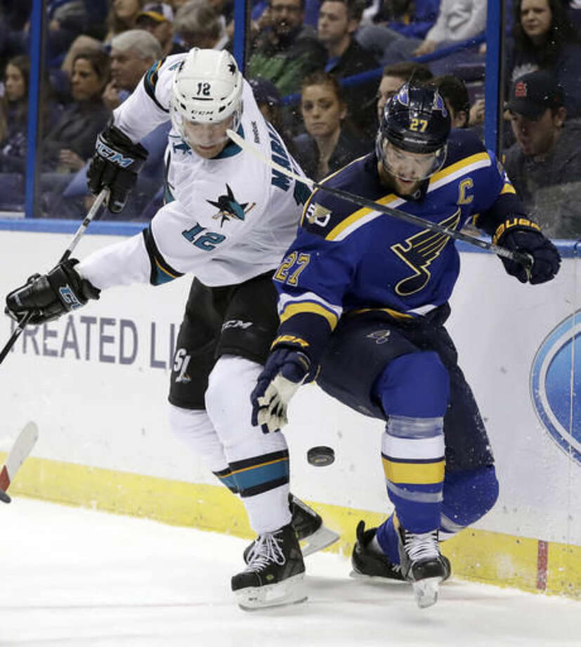 St. Louis Blues' Alex Pietrangelo, right, and San Jose Sharks' Patrick Marleau keep their eye on the puck during the first period of an NHL hockey game Thursday, Nov. 17, 2016, in St. Louis. (AP Photo/Jeff Roberson)