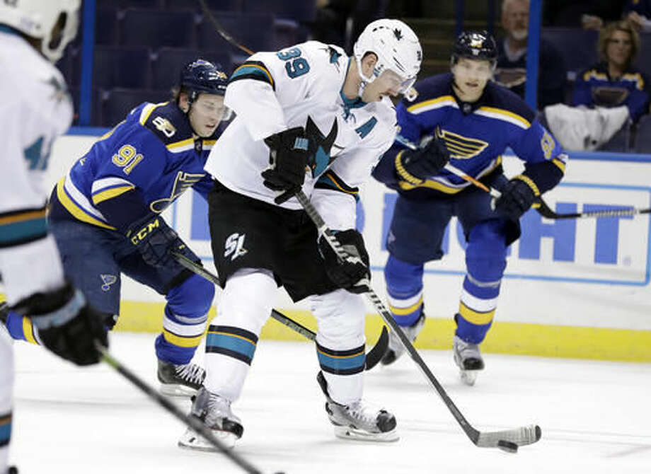 San Jose Sharks' Logan Couture (39) controls the puck before scoring as St. Louis Blues' Vladimir Tarasenko, of Russia, and Colton Parayko, right, defend during the first period of an NHL hockey game Thursday, Nov. 17, 2016, in St. Louis. (AP Photo/Jeff Roberson)
