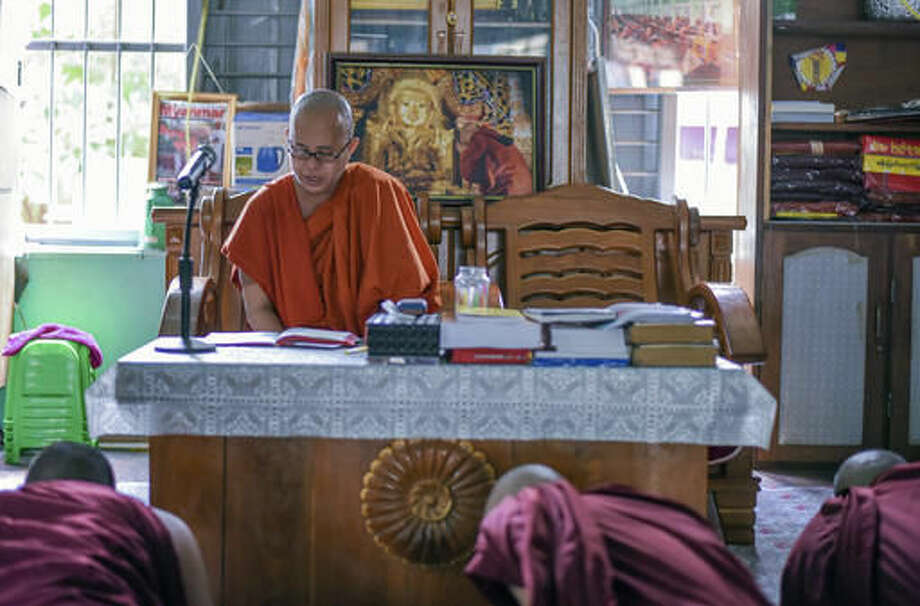 In this Nov. 12, 2016 photo, Ashin Wirathu, a high-profile leader of the Myanmar Buddhist organization known as Ma Ba Tha, teaches some younger novice monks at his monastery in Mandalay, Myanmar. Shunned by Myanmar's new government and its Buddhist hierarchy, the nationalist monk blamed for whipping up at times bloody anti-Muslim fervor said he feels vindicated by U.S. voters who elected Donald Trump to be president. (AP Photo/Aung Naing Soe)
