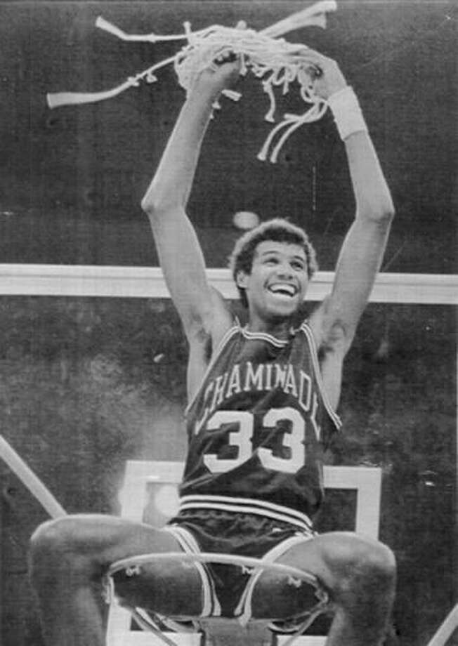 FILE - In this Dec. 23, 1982, file photo, Chaminade's Richard Haenisch sits atop the basket celebrating the team's 77-72 win over No. 1 Virginia in a college basketball game in Honolulu. Chaminade's 77-72 victory over Ralph Sampson and top-ranked Virginia in 1982 is widely considered the biggest upset in college basketball, among the greatest in any sport. Unlike today's world of 24-hour sports networks, social media and smartphones, the game was played in relative obscurity. (AP Photo/The Star-Advertiser, File)