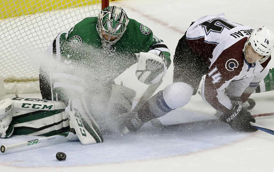 Dallas Stars goalie Kari Lehtonen, left, defends the goal against Colorado Avalanche left wing Blake Comeau (14) during the second period of an NHL hockey game in Dallas, Thursday, Nov. 17, 2016. (AP Photo/LM Otero)