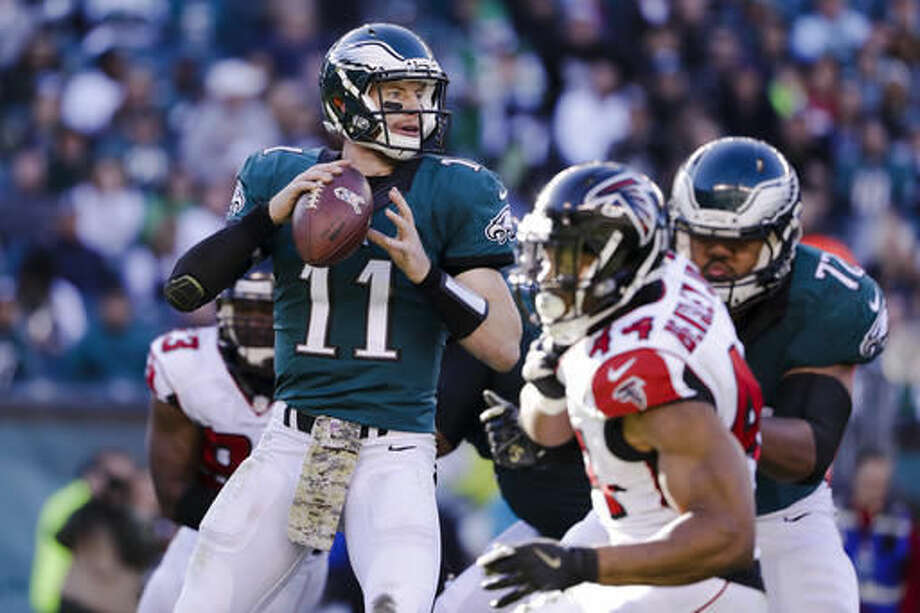 FILE - In this Sunday, Nov. 13, 2016 file photo, Philadelphia Eagles quarterback Carson Wentz (11) looks to pass during an NFL football game against the Atlanta Falcons in Philadelphia. The duo of Seattle Seahawks' Earl Thomas and strong safety Kam Chancellor are just two of the challenges rookie Carson Wentz has to face when the Philadelphia Eagles travel to Seattle on Sunday, Nov. 20, 2016.(AP Photo/Matt Rourke, File)