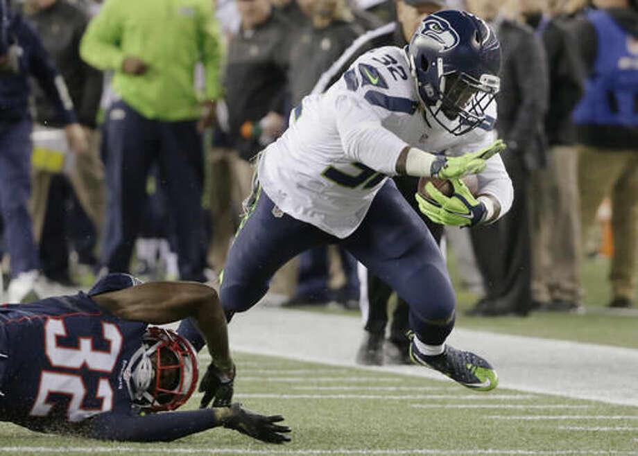 FILE - In this Nov. 13, 2016, file photo, Seattle Seahawks running back Christine Michael, right, eludes New England Patriots defensive back Devin McCourty, left, during the first half of an NFL football game in Foxborough, Mass. In Clay Matthews and now Michael, Green Bay has two players who can only help in areas on opposite sides of the ball in which production has tailed off of late. (AP Photo/Steven Senne, File)