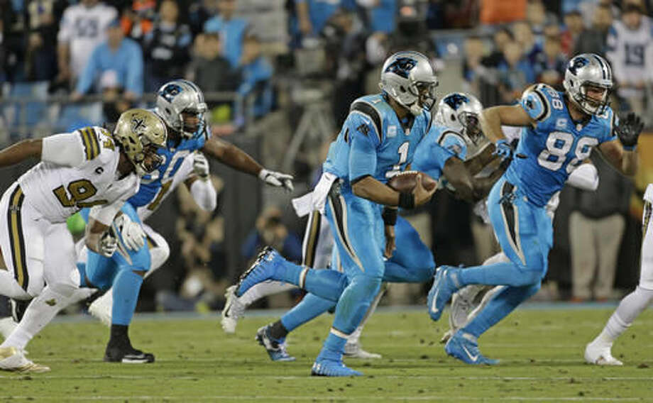 Carolina Panthers' Cam Newton (1) scrambles against the New Orleans Saints in the first half of an NFL football game in Charlotte, N.C., Thursday, Nov. 17, 2016. (AP Photo/Bob Leverone)