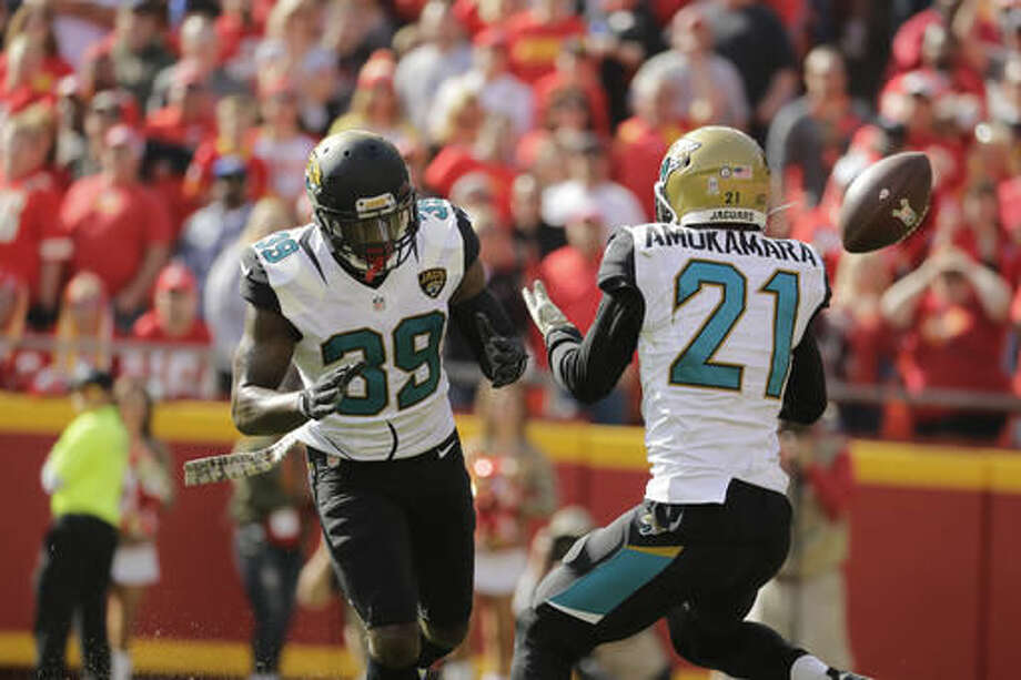 FILE - In this Nov. 6, 2016, file photo, Jacksonville Jaguars cornerback Prince Amukamara (21) nearly intercepts a ball with safety Tashaun Gipson (39) looking on, during the first half of an NFL football game against the Kansas City Chiefs, in Kansas City, Mo. The Jaguars (2-7) have gone nearly six games _ more than 23 quarters or 289 minutes, 21 seconds to be exact _ without a takeaway. The five-game streak is tied for the longest drought in the NFL since the 1970 merger, according to Pro Football Reference. (AP Photo/Charlie Riedel, File)