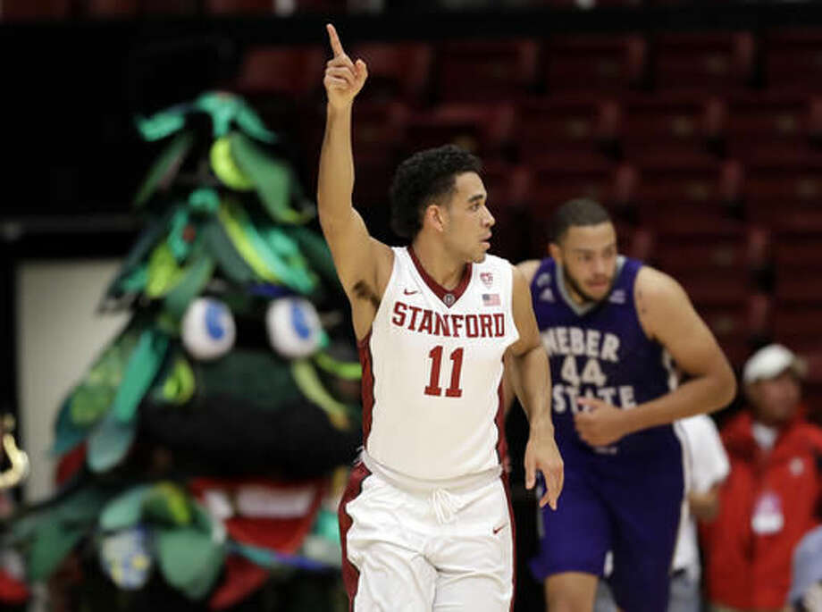 Stanford guard Dorian Pickens (11) celebrates after scoring against Weber State during the first half of an NCAA college basketball game Thursday, Nov. 17, 2016, in Stanford, Calif. (AP Photo/Marcio Jose Sanchez)