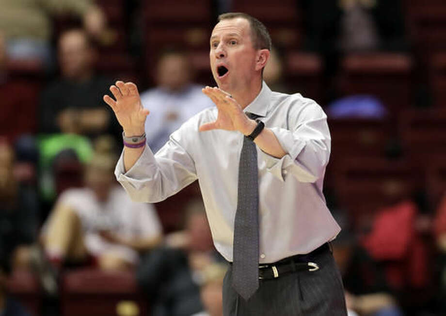 Weber State coach Randy Rahe talks to his team against Stanford during the first half of an NCAA college basketball game Thursday, Nov. 17, 2016, in Stanford, Calif. (AP Photo/Marcio Jose Sanchez)