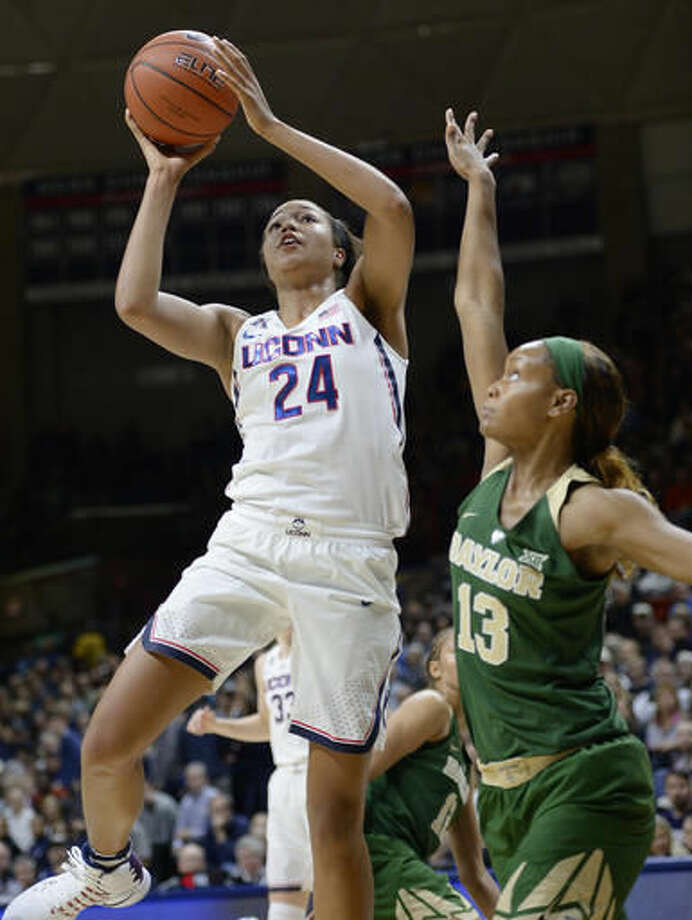 Connecticut's Napheesa Collier, left, shoots over Baylor's Nina Davis, right, in the first half of an NCAA college basketball game, Thursday, Nov. 17, 2016, in Storrs, Conn. (AP Photo/Jessica Hill)