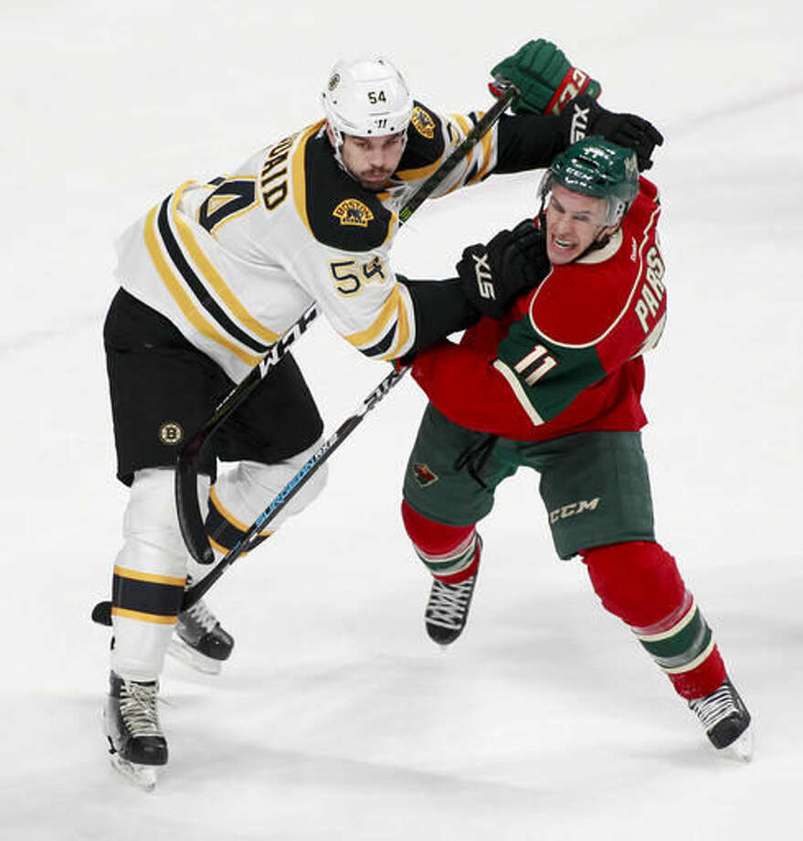 Minnesota Wild left wing Zach Parise (11) battles for position against Boston Bruins defenseman Adam McQuaid (54) in front of the Boston net during the first period of an NHL hockey game, Thursday, Nov. 17, 2016, in St. Paul, Minn. (AP Photo/Paul Battaglia)