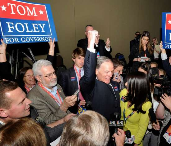 Tom Foley, raises his fist the moment it is announced that he has the votes to be the Republican candidate for governor. The Republican State Convention was being held at the Hartford Convention Center, Saturday, May 22, 2010. Photo: Carol Kaliff / The News-Times