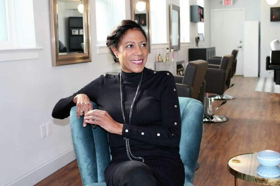 Elan McDowell, proprietor of Studio Elan on Elm Street, sits in her salon on Nov. 22 in New Canaan. Photo: Justin Papp / Hearst Connecticut Media / New Canaan News