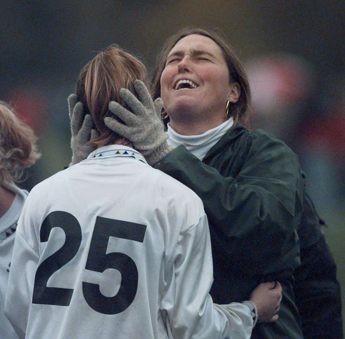 TIMES UNION PHOTO BY LUANNE M. FERRIS - SATURDAY, NOV. 1, 1997, CLIFTON PARK, CLIFTON COMMONS SOCCER FIELD. Shenendehowa Assistant Coach Betsy Drambour celebrates with Shenendehowa's Erin Lilly after Shenendehowa won the Section II, Class A girls soccer finals1-0 over Niskayuna.