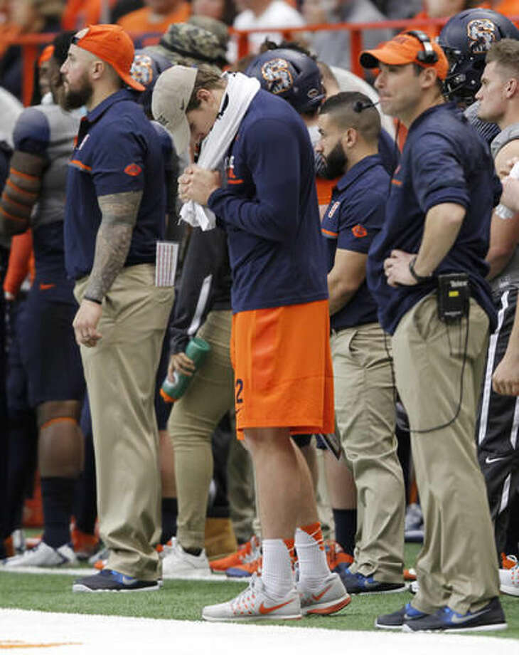 Syracuse's starting quarterback Eric Dungey, center, stands the Syracuse sidelines in the final seconds of an NCAA college football game against North Carolina State in Syracuse, N.Y., Saturday, Nov. 12, 2016. Dungey could not play because of an injury. North Carolina State won 35-20. (AP Photo/Nick Lisi)