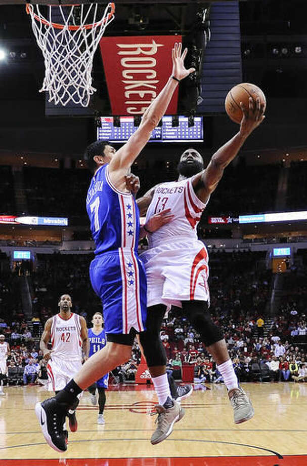 edb799a7ab9c Houston Rockets guard James Harden (13 shoots the ball as Philadelphia  76ers forward Ersan Ilyasova