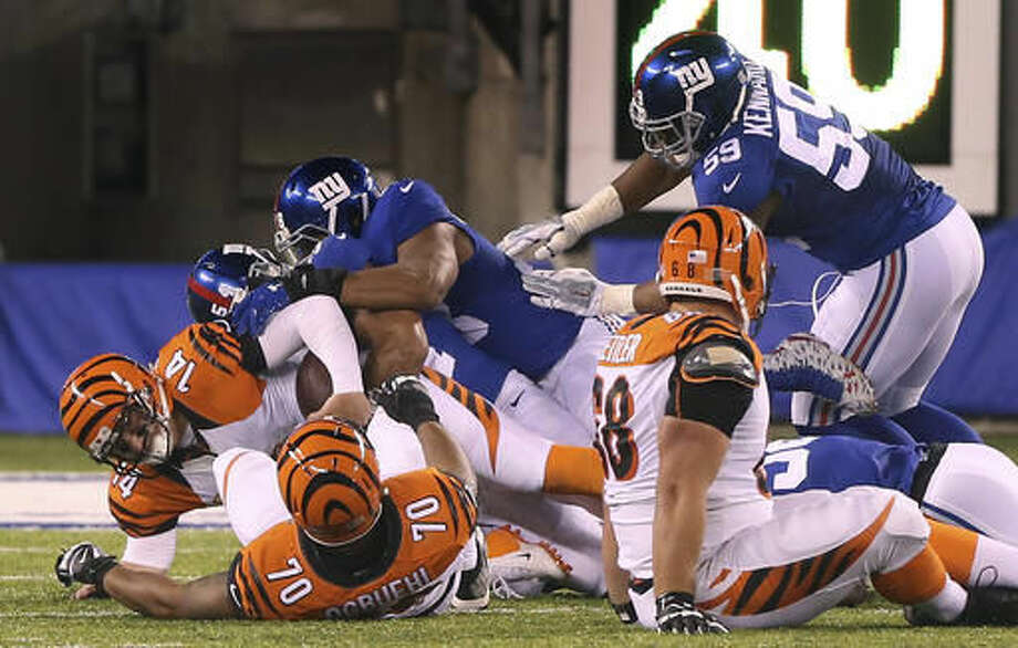 Cincinnati Bengals quarterback Andy Dalton (14) is sacked by New York Giants defensive end Olivier Vernon (54) during the fourth quarter of an NFL football game, Monday, Nov. 14, 2016, in East Rutherford, N.J. (AP Photo/Seth Wenig)