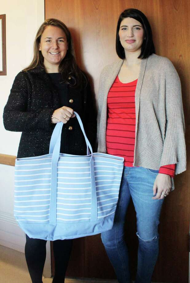 Jen Stocker (left) gives a bag to Elizabeth Borovan of Cos Cob before she's discharged on Nov. 28, 2016. Borovan just gave birth to her second son, Sebastian, at Stamford Hospital in Stamford, CT. Photo: Erin Kayata / Hearst Connecticut Media / Darien News