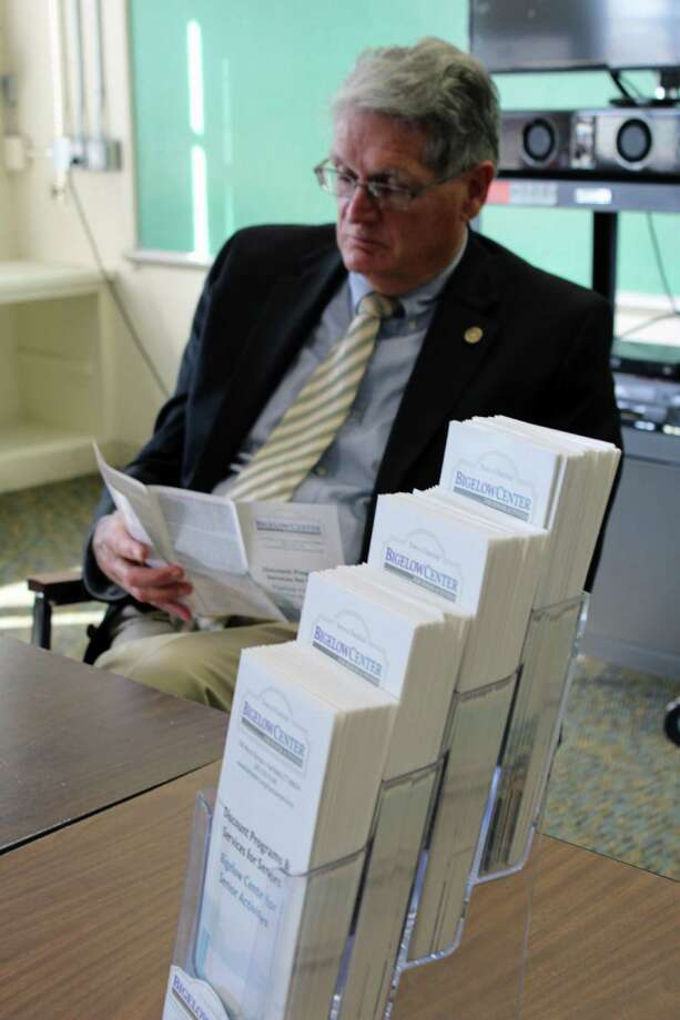 Human Services Commission member Bruce Carter looks over the newly released brochure listing all the available senior citizen discounts at local merchants. Fairfield, CT. 11/28/16 Photo: Genevieve Reilly / Hearst Connecticut Media / Fairfield Citizen