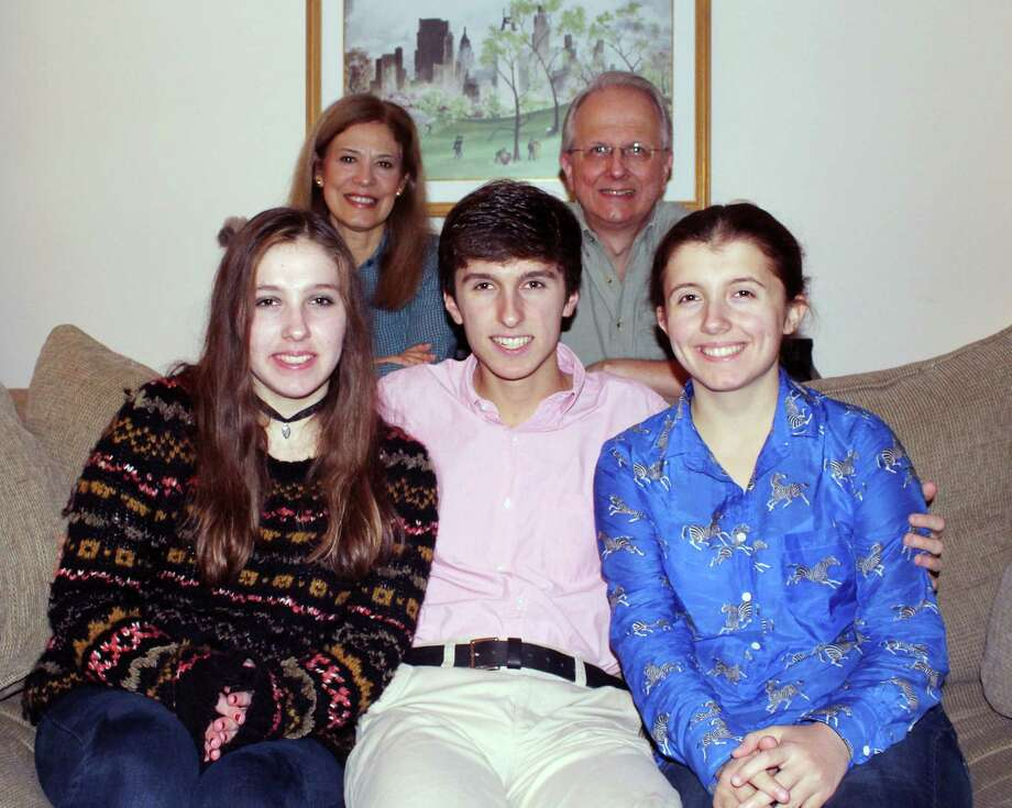 """Michael Borecki poses with his sisters Claire, left, and Elizabeth, right, along with his parents Yvette and Ken in their home in Darien. Michael, a senior at Darien High School, appeared on the """"Jeopardy! Teen Tournament"""" in November. Photo: Erin Kayata / Hearst Connecticut Media / Darien News"""