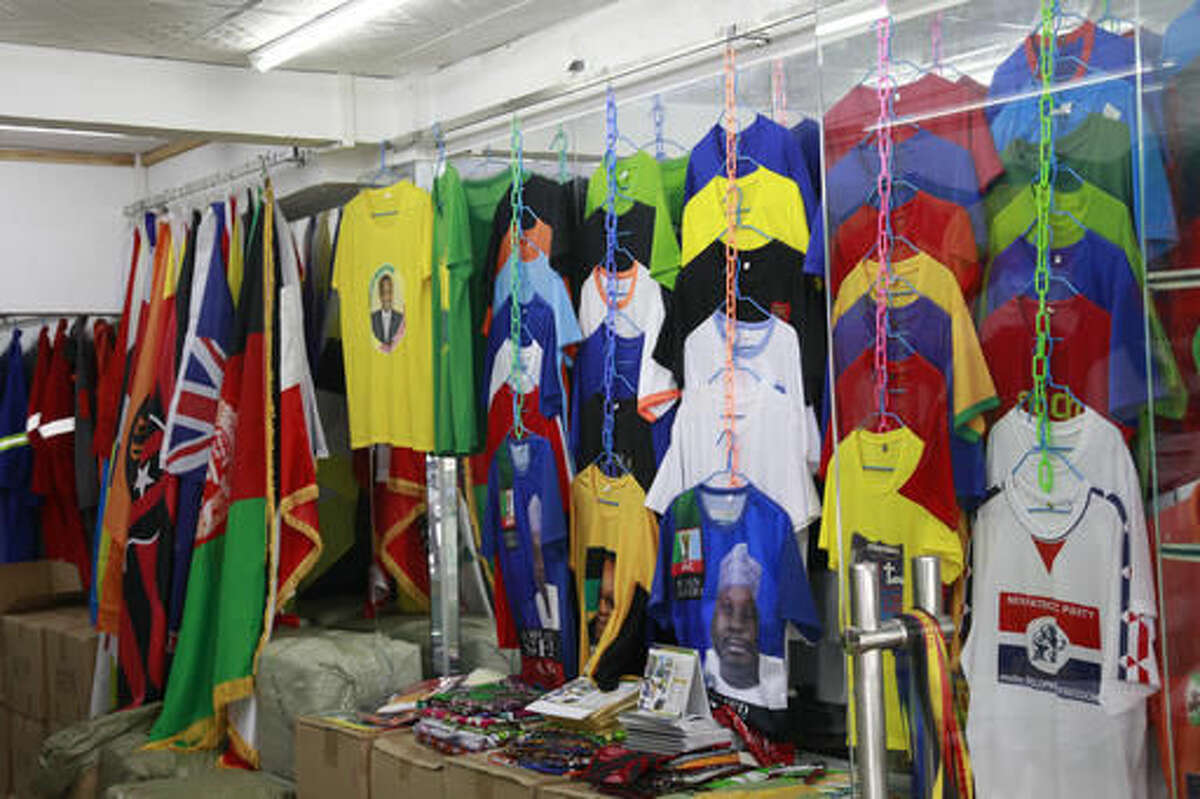 In this Thursday, Aug. 11, 2016, photo, a shop sells t-shirts catering to the local African communities in Guangzhou in southern China's Guangdong province. (AP Photo/Louise Watt)