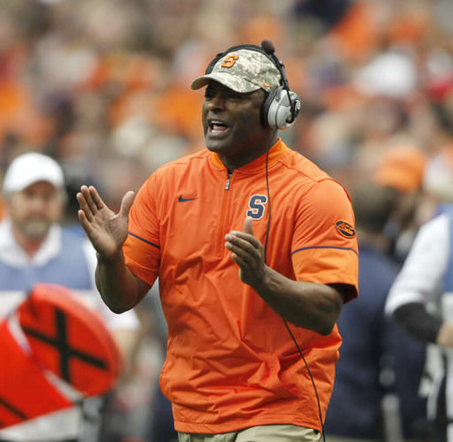 Syracuse head coach Dino Babers yells to his players in the fourth quarter of an NCAA college football game against North Carolina State in Syracuse, N.Y., Saturday, Nov. 12, 2016. (AP Photo/Nick Lisi)
