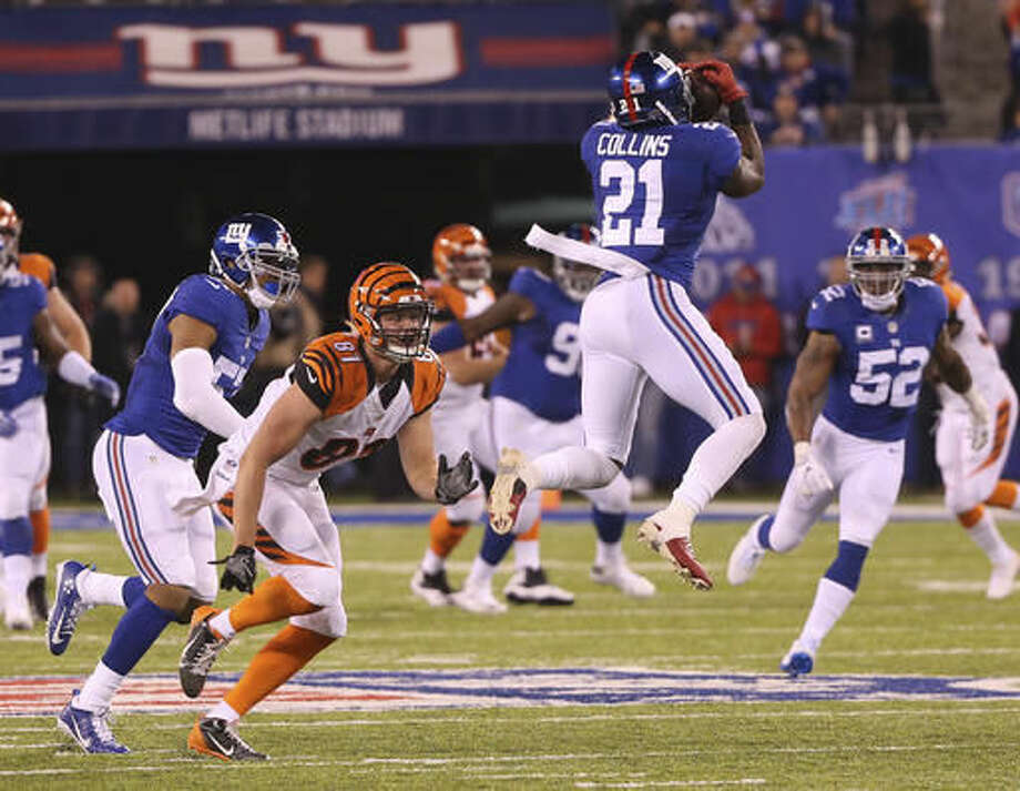New York Giants strong safety Landon Collins (21) intercepts a pass from the Cincinnati Bengals during the fourth quarter of an NFL football game, Monday, Nov. 14, 2016, in East Rutherford, N.J. (AP Photo/Seth Wenig)