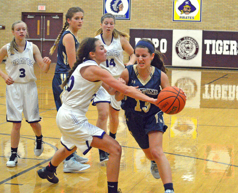 Father McGivney senior Rachel Kassing, right, drives to the basket during the third quarter of Tuesday's game against Valmeyer at the Dupo Cat Classic.