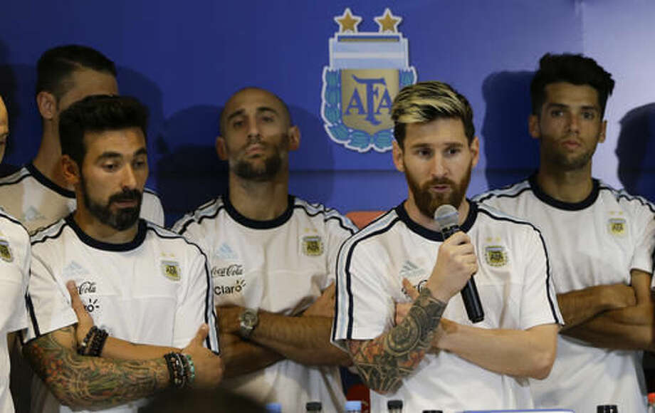 Argentina's Lionel Messi, second right, talks surrounded by the teammates after a 2018 Russia World Cup qualifying soccer match against Colombia in San Juan, Argentina, Wednesday, Nov. 16, 2016. Messi said players will not talk to press anymore because they consider that the press is being disrespectful. (AP Photo/Natacha Pisarenko)