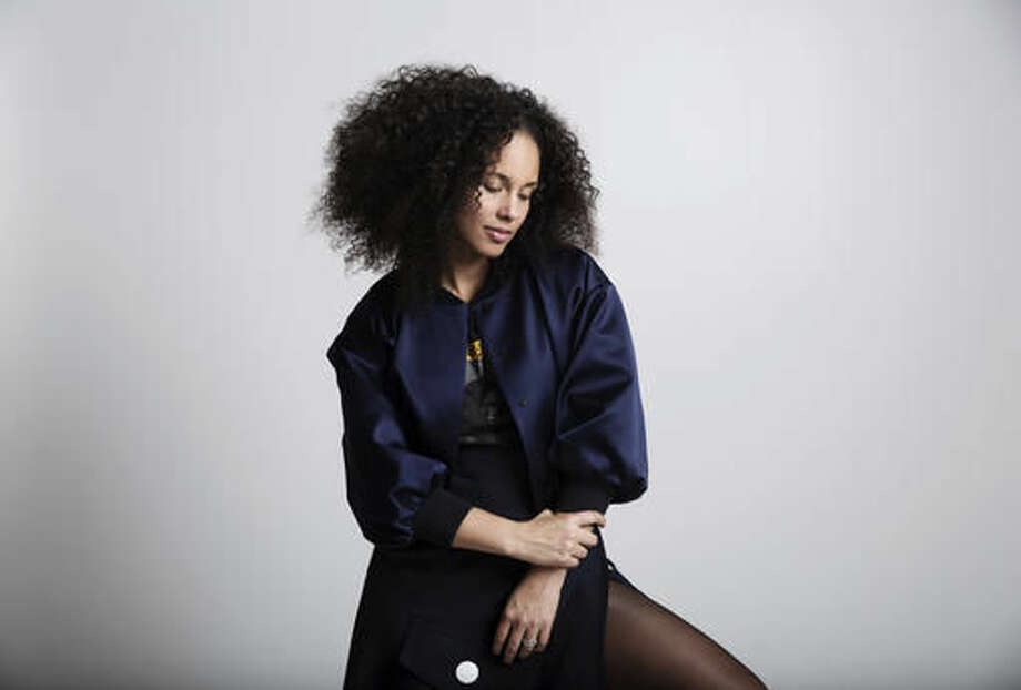 """In this Nov. 2, 2016 photo, Alicia Keys poses for a portrait in New York, to promote her sixth album, """"Here."""" (Photo by Taylor Jewell/Invision/AP)"""