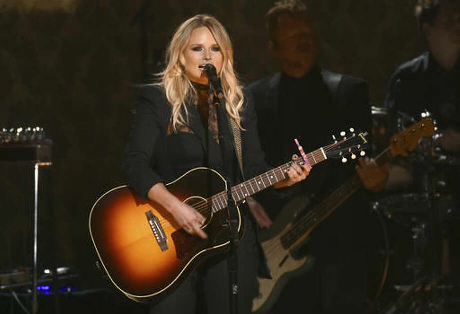 "FILE - In this Nov. 2, 2016 file photo, Miranda Lambert performs ""Vice"" at the 50th annual CMA Awards at the Bridgestone Arena in Nashville, Tenn. Double albums are rare these days and the best ones came out decades ago in vinyl form. Lambert revives that tradition in an expansive new album, ""The Weight of These Wings,"" which emphasizes the duality of her personality on disc A's ""The Nerve"" and disc B's ""The Heart."" At times, the album feels a bit repetitive, but there are enough standout songs to make it worth the extra time.(Photo by Charles Sykes/Invision/AP)"
