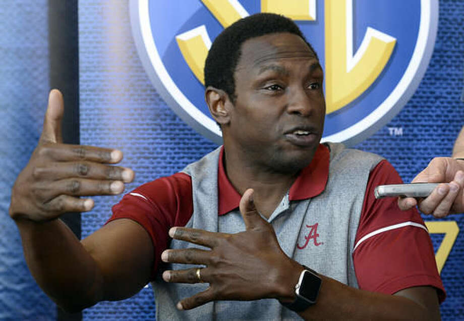 FILE - In this Oct. 19, 2016, file photo, Alabama coach Avery Johnson answers a question during the Southeastern Conference men's NCAA college basketball media day, in Nashville, Tenn. Alabama's Avery Johnson and Auburn's Bruce Pearl have taken the basketball programs into recruiting territory normally only occupied by the football programs. (AP Photo/Mark Zaleski, File)