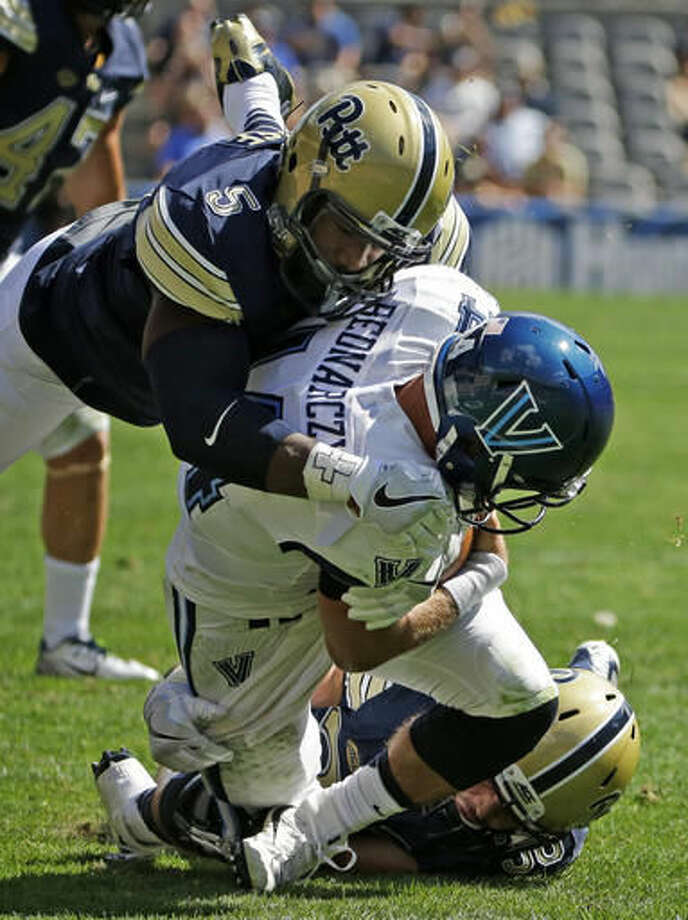 FILE - In this Sept. 3, 2016, file photo, Villanova quarterback Zach Bednarczyk, center, is sacked by Pittsburgh linebacker Mike Caprara, bottom, and Ejuan Price (5), top, during the first half of an NCAA college football game in Pittsburgh. Ejuan Price arrived at Pittsburgh in the fall of 2011 confident he could make a difference. The defensive end just didn't think he'd have to wait so long. (AP Photo/Gene J. Puskar, File)