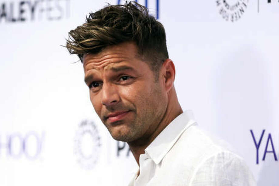 FILE - In this Sept. 10, 2015 file photo, Ricky Martin arrives at the at 2015 PaleyFest Fall TV Previews in Beverly Hills, Calif. Martin said he recently proposed to conceptual artist Jwan Yosef, whom he met a year ago after becoming a fan of Yosef's work. This is the first marriage for each. (Photo by Rich Fury/Invision/AP, File)