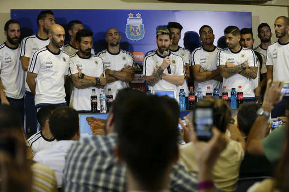 Argentina's Lionel Messi, center, talks surrounded by the teammates after a 2018 Russia World Cup qualifying soccer match against Colombia in San Juan, Argentina, Wednesday, Nov. 16, 2016. Messi said players will not talk to press anymore because they consider that the press is being disrespectful. (AP Photo/Natacha Pisarenko)