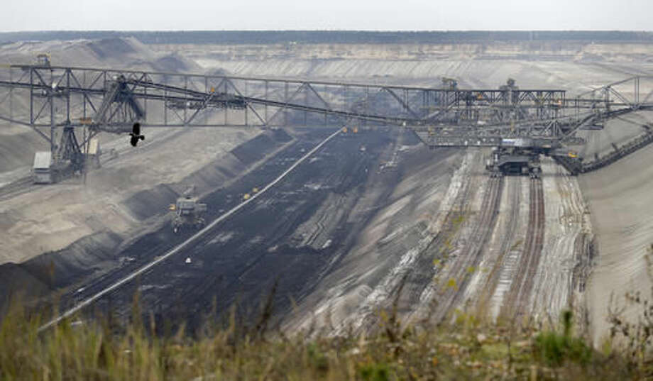 In this Friday, Oct. 28, 2016 photo the LEAG (Lusatian Energy Stock Company) lignite open-cast mine is pictured in Jaenschwalde, eastern Germany. Scientists studying lifetime emissions of the world's current energy infrastructure say coal plants alone would blow the budget for 1.5 degrees C of warming, the lower threshold in the Paris climate agreement. (AP Photo/Michael Sohn)