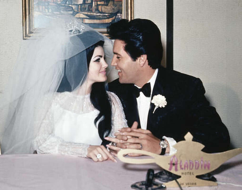 """FILE - In this May 1, 1967, file photo, singer Elvis Presley and his bride, the former Priscilla Beaulieu, appear at the Aladdin Hotel in Las Vegas, after their wedding. Priscilla Presley opened up about her life with Elvis during a Nov. 16, 2016, interview on British chat show, """"Loose Women,"""" on the ITV network. (AP Photo/File)"""