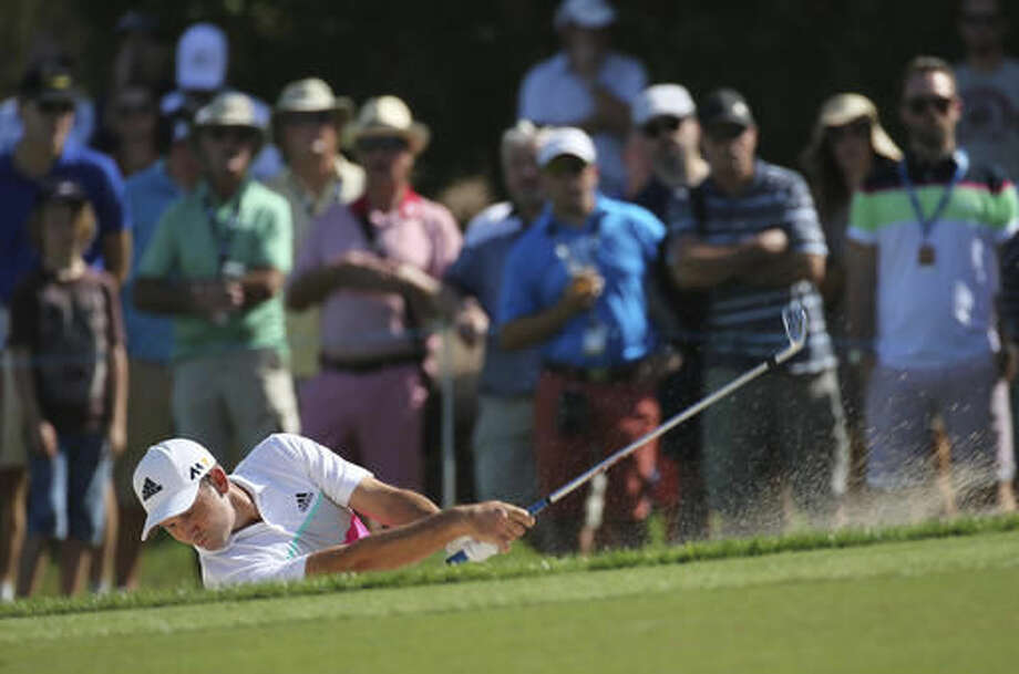 Sergio Garcia of Spain plays a bunker shot on the 1st hole during the 2nd round of the DP World Tour Championship golf tournament at the Jumeirah Golf Estates in Dubai, United Arab Emirates, Friday, Nov. 18, 2016. (AP Photo/Kamran Jebreili)