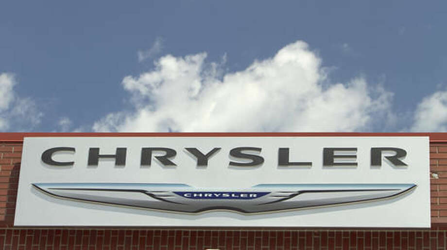 FILE - In this July 22, 2011 file photo, the Chrysler logo is displayed at a car dealership in Omaha, Neb. Fiat Chrysler is recalling nearly 89,000 cars and SUVs to fix possible fuel leaks or problems with windshield wipers, Friday, Nov. 18, 2016. The most serious recall covers nearly 35,000 Dodge Durango and Jeep Grand Cherokee SUVs worldwide from the 2016 model year. All have 3.6-liter V6 engines. A fuel tube may have been damaged in manufacturing, and that could cause a gas leak and fire. (AP Photo/Nati Harnik)
