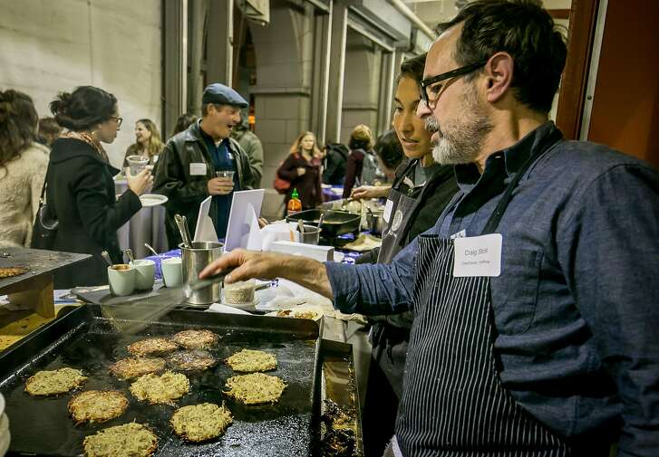 Chef Craig Stoll cooks the Everything Latke fried in Duck Fat at the Illuminoshi Latke showdown at the Ferry Building in San Francisco, Calif. is seen on December 5th, 2016.