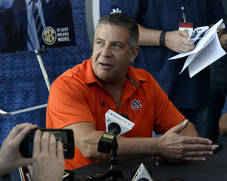 FILE - In this Oct. 19, 2016, file photo, Auburn coach Bruce Pearl answers a question during the Southeastern Conference men's NCAA college basketball media day, in Nashville, Tenn. Alabama's Avery Johnson and Auburn's Bruce Pearl have taken the basketball programs into recruiting territory normally only occupied by the football programs. . (AP Photo/Mark Zaleski, File)