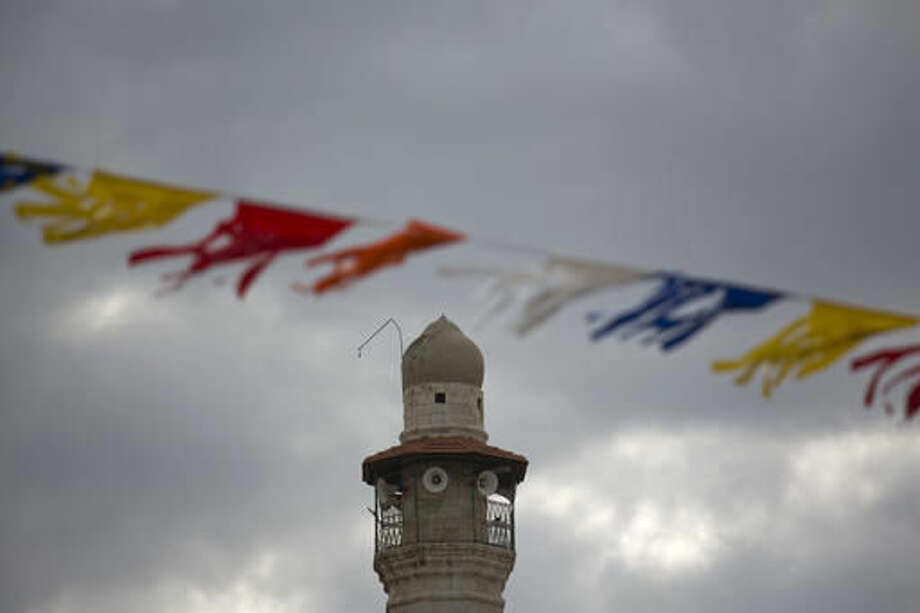 The minaret of a mosque is seen in Lod, a mixed Jewish Muslim and Christian city in central Israel, Wednesday, Nov. 16, 2016. Israeli Prime Minister Benjamin Netanyahu is championing a bill that would force mosques in Israel to reduce the volume of the Muslim call to prayer intoned through loudspeakers five times a day. The bill is unlikely to advance in its current form, but it echoes similar concerns from the rising right-wing in Europe _ and touches upon the deep fissure the country has with its Arab citizens. (AP Photo/Ariel Schalit)