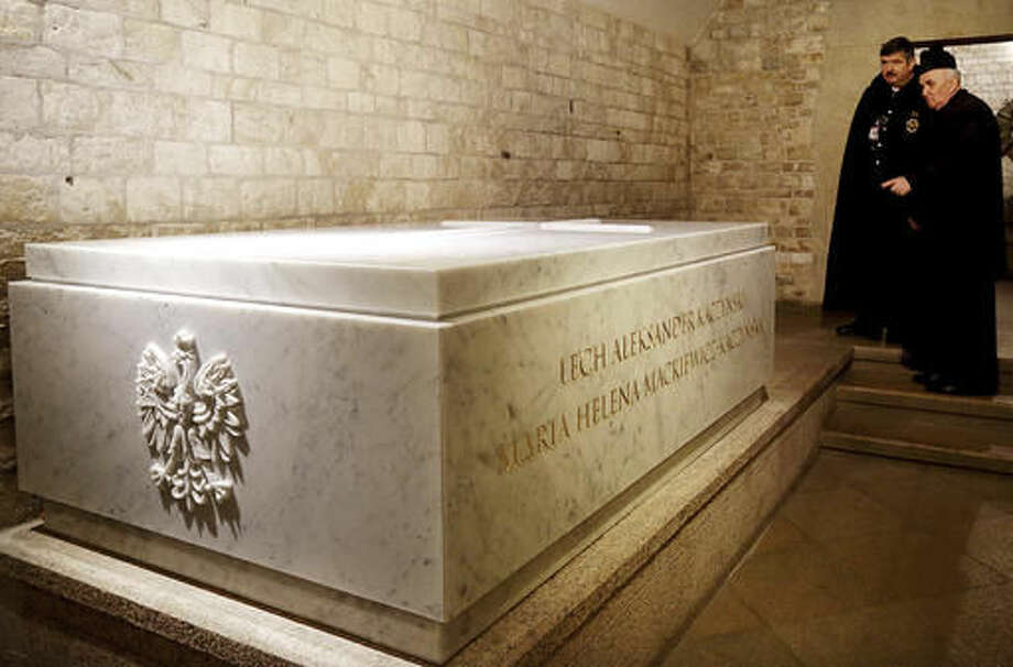Priests discussing the ceremony of the reburial of Poland's former President Lech Kaczynski and his wife in St. Leonard's Crypt at the Wawel cathedral in Krakow, Poland on Friday, Nov. 18, 2016. The couple who died with 94 others in a plane crash in 2010 were exhumed Nov.14, 2016 for forensic examination that is to determine the cause of their deaths and of the crash, amid theories circulated by the ruling party that the crash was an assassination attack. The presidential couple are to be laid to rest again in a new white Carrara marble tomb on Friday, in the presence of President Andrzej Duda and Prime Minister Beata Szydlo. (AP Photo/Jarek Praszkiewicz)