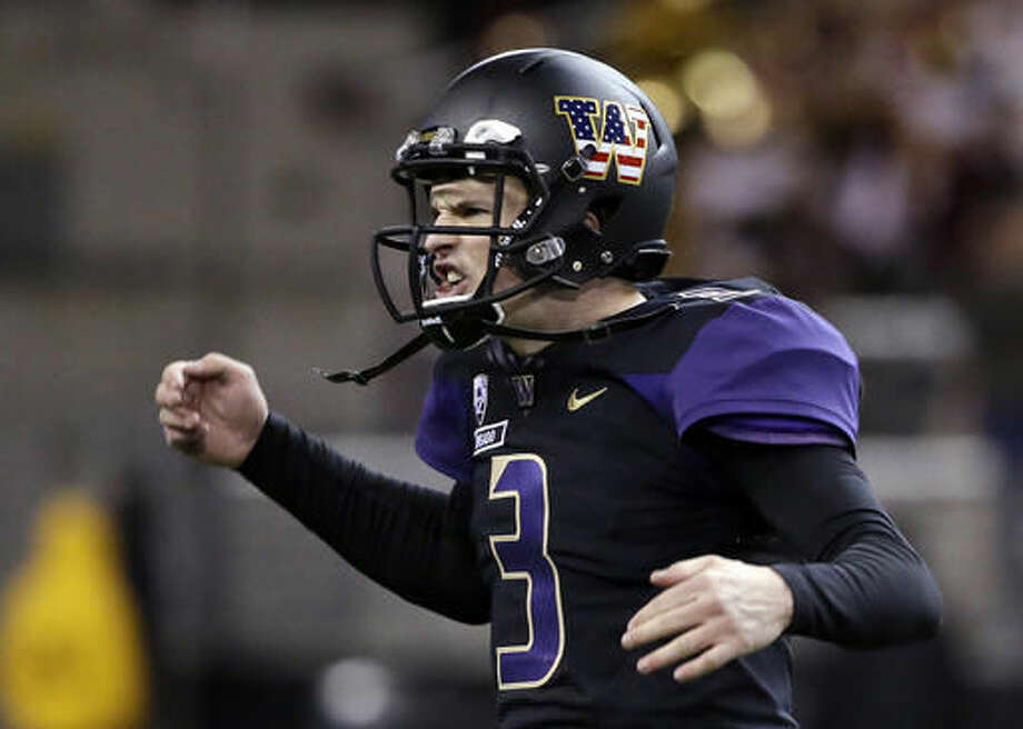 Washington quarterback Jake Browning reacts after throwing a touchdown pass against Southern California in the second half of an NCAA college football game Saturday, Nov. 12, 2016, in Seattle. USC won 26-13. (AP Photo/Elaine Thompson)