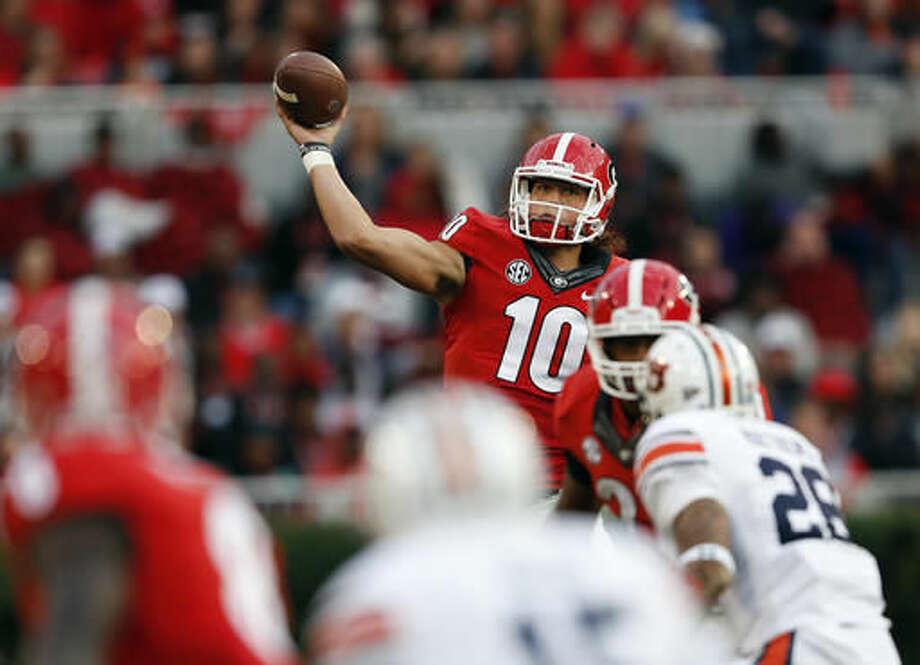 Georgia quarterback Jacob Eason (10) throws against Auburn in the first half of an NCAA college football game Saturday, Nov. 12, 2016, in Athens, Ga. (AP Photo/John Bazemore)