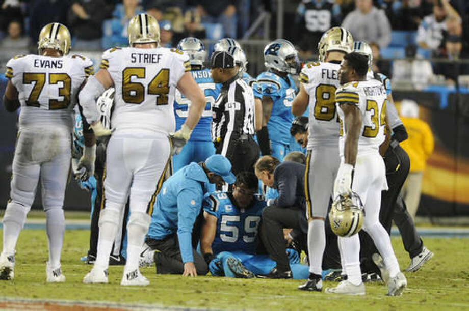 Carolina Panthers' Luke Kuechly (59) is helped on the field after being injured against the New Orleans Saints in the second half of an NFL football game in Charlotte, N.C., Thursday, Nov. 17, 2016. (AP Photo/Mike McCarn)