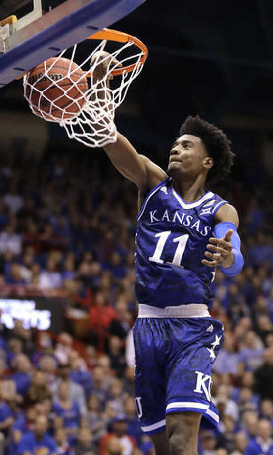 Kansas' Josh Jackson dunks the ball during the first half of an NCAA college basketball game against Siena Friday, Nov. 18, 2016, in Lawrence, Kan. (AP Photo/Charlie Riedel)