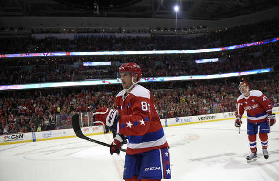 Washington Capitals center Jay Beagle (83) celebrates his goal as he skates to the bench during the third period of an NHL hockey game against the Detroit Red Wings, Friday, Nov. 18, 2016, in Washington. The Capitals won 1-0. (AP Photo/Nick Wass)